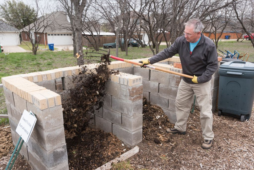 Willie Lane adds material to compost at the Giving Garden of Carrollton. Gardeners who participate donate at least half of what they produce to local food pantries. (Rex C. Curry/Special Contributor)