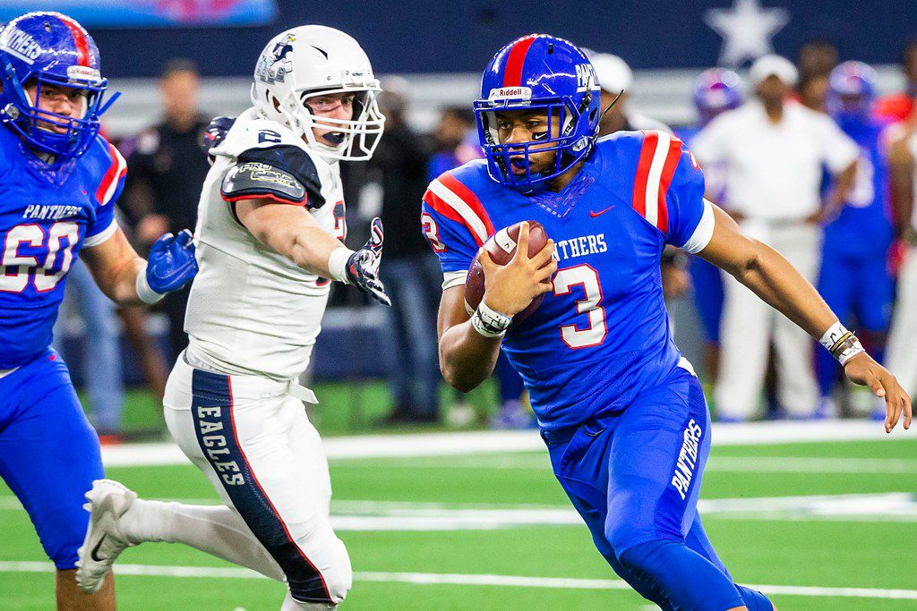 Duncanville quarterback Ja'Quinden Jackson (3) races past Allen linebacker Jaden Healy (2) on a 8-yard touchdown run during the first half of a Class 6A Division IÊstate semifinal at AT&T Stadium on Saturday, Dec. 15, 2018, in Arlington. (Smiley N. Pool/The Dallas Morning News)