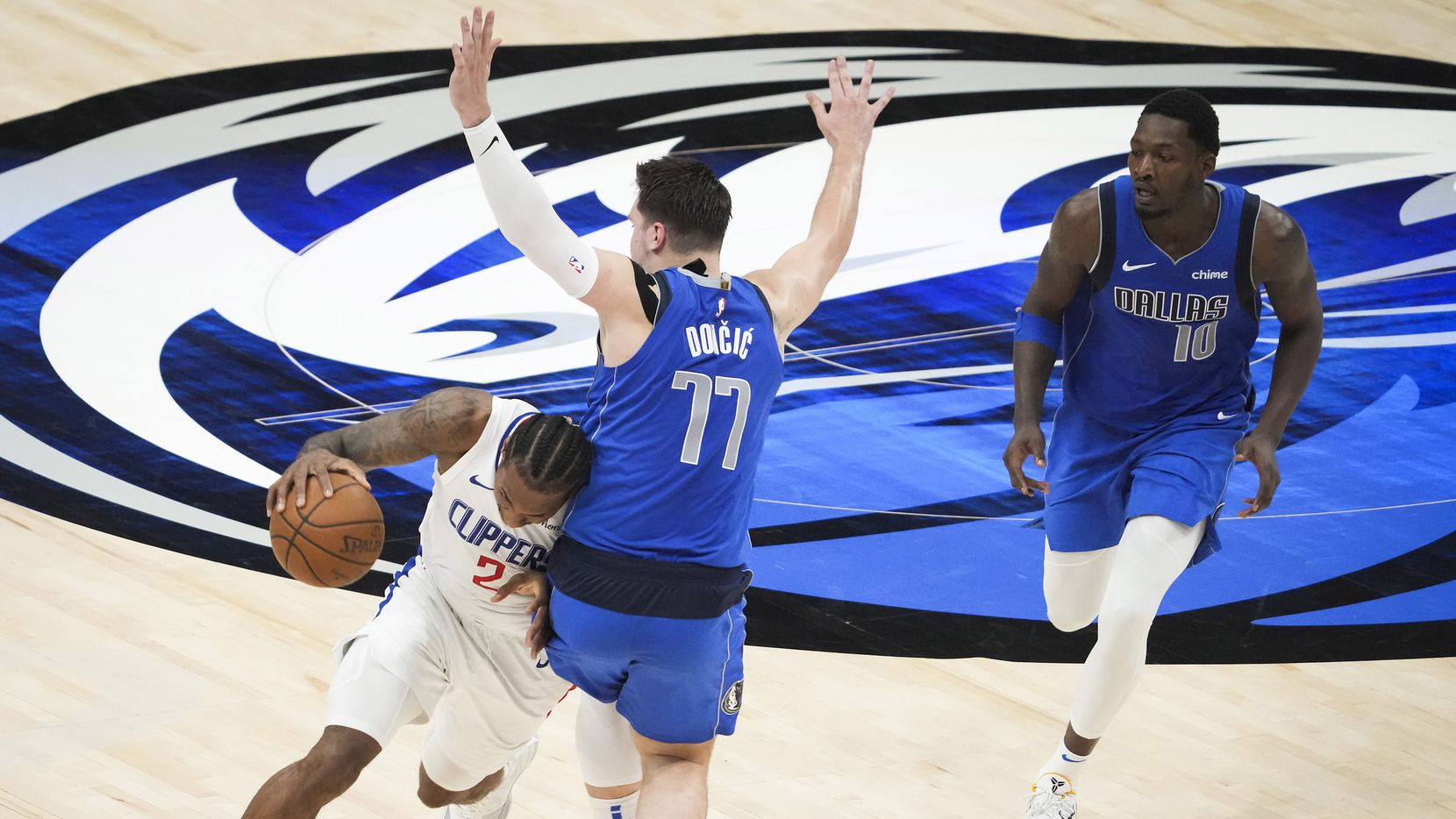 LA Clippers forward Kawhi Leonard (2) drives past Dallas Mavericks guard Luka Doncic (77) during the fourth quarter of an NBA playoff basketball game at the American Airlines Center on Friday, June 4, 2021, in Dallas. The Clippers won the game 104-97.