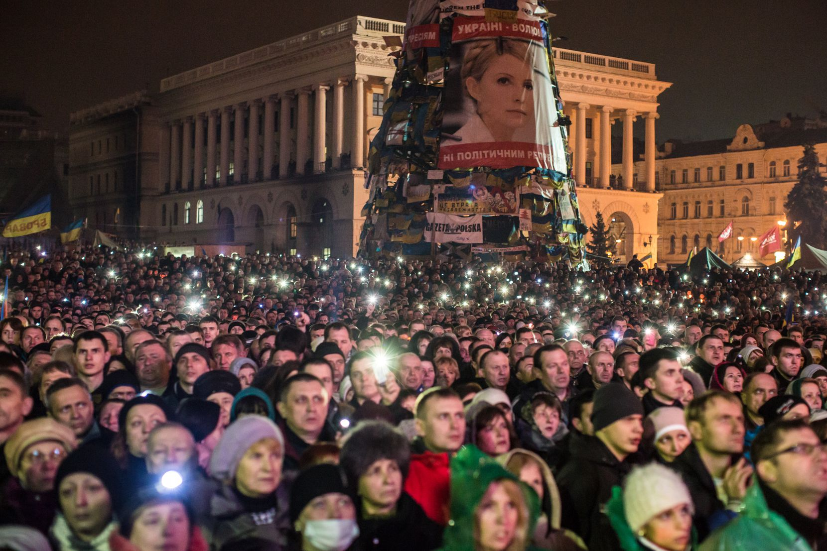A large photograph of former Prime Minister Yulia Tymoshenko hangs on the side of a structure on Independence Square before her address to anti-government protesters gathered in Kiev. The leader of the 2004 Orange Revolution against current embattled President Viktor Yanukovych traveled to Kiev to address the crowd immediately after being released from prison on what many claim were politically motivated charges.