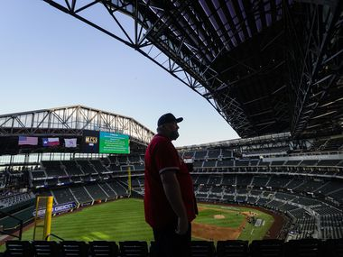 Atlanta Braves fan Michael DeBord, who is originally from Atlanta but now lives in North Texas, watches the retractable roof opening before Game 1 of a National League Championship Series between the Los Angeles Dodgers and the Atlanta Braves at Globe Life Field on Monday, Oct. 12, 2020.