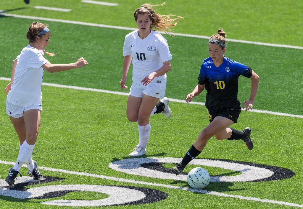 Grapevine's Sidney McGregor (3) and Ashton Wright defend San Antonio Alamo Heights' Dawson Brinkley (10) during the Class 5A girls soccer state semifinal in Georgetown, Thursday, April 19, 2018. (Stephen Spillman/Special Contributor)