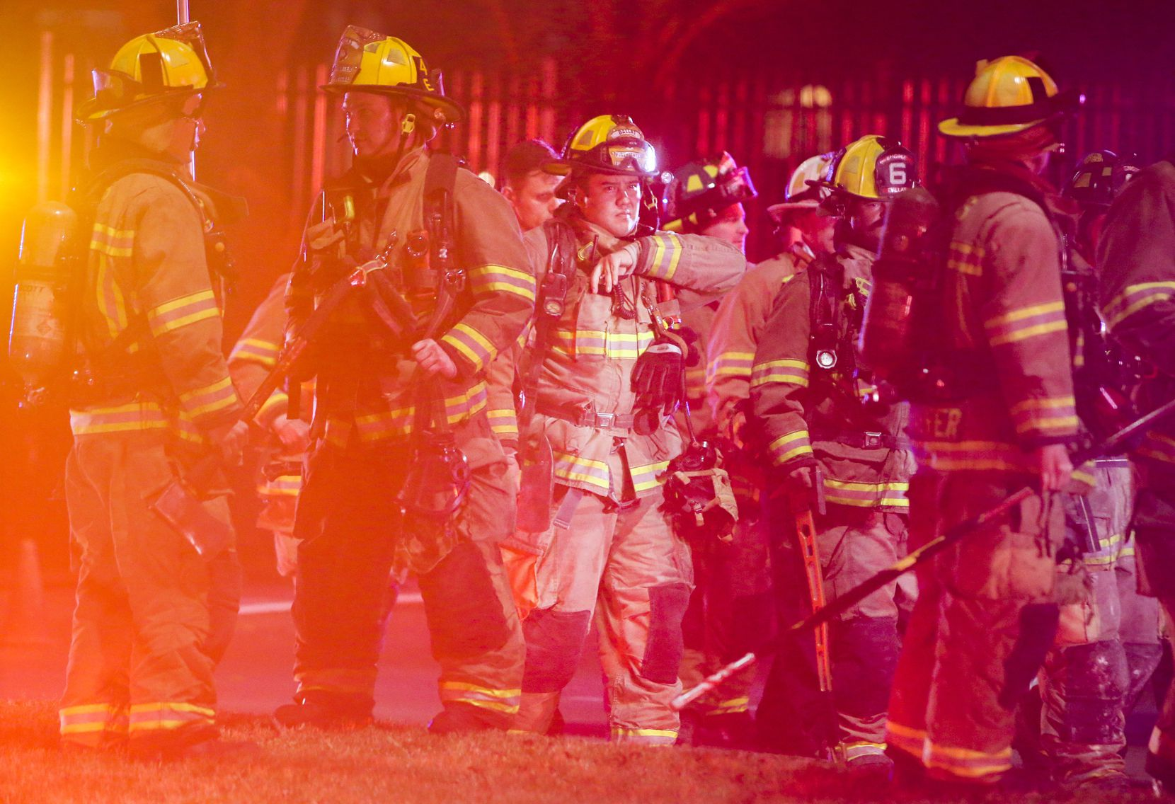 Emergency personnel work at the scene of an underground electrical vault fire in the 300 block of South Cesar Chavez Boulevard, between Jackson and Canton streets on Saturday, Feb. 2, 2019 in Dallas.