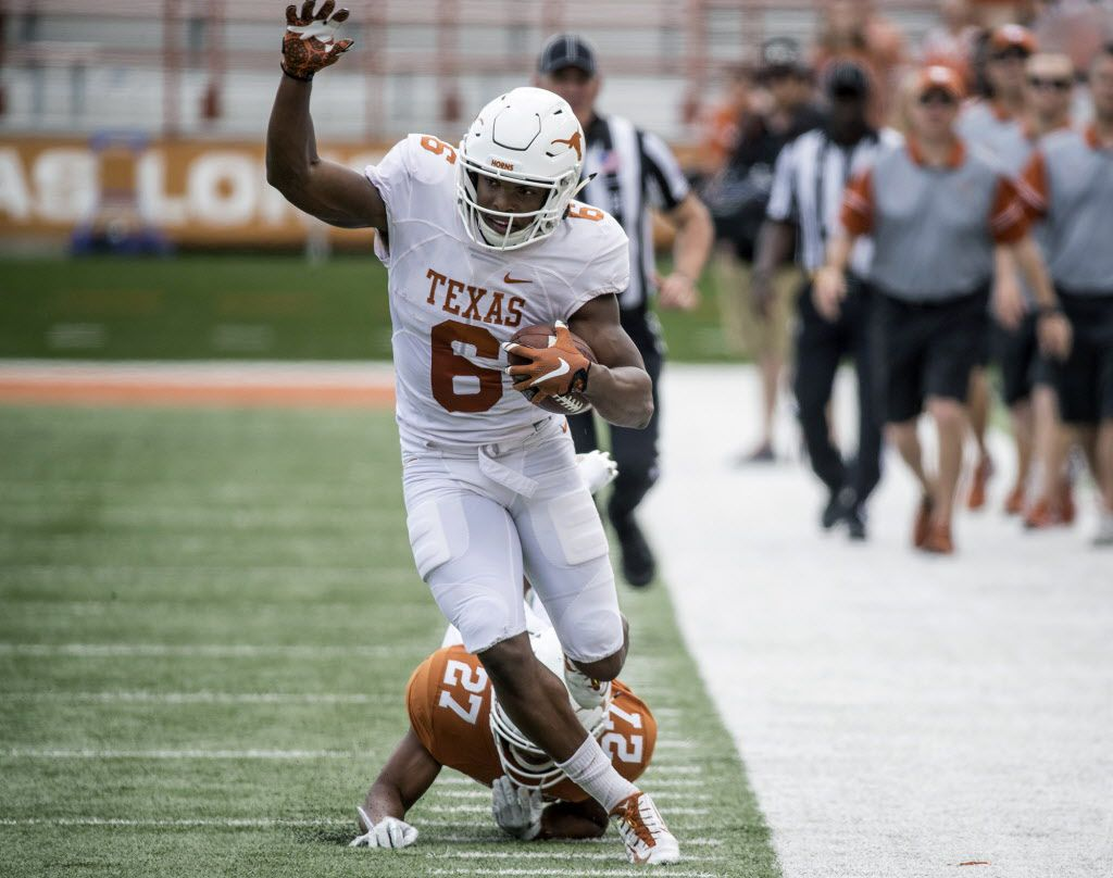 Texas' (6) Devin Duvernay tries to stay in bounds after beating (27) Donovan Duvernay on the play during the orange and white NCAA college spring football game Saturday, April 15, 2017, in Austin, Texas. (Ricardo B. Brazziell/Austin American-Statesman via AP)