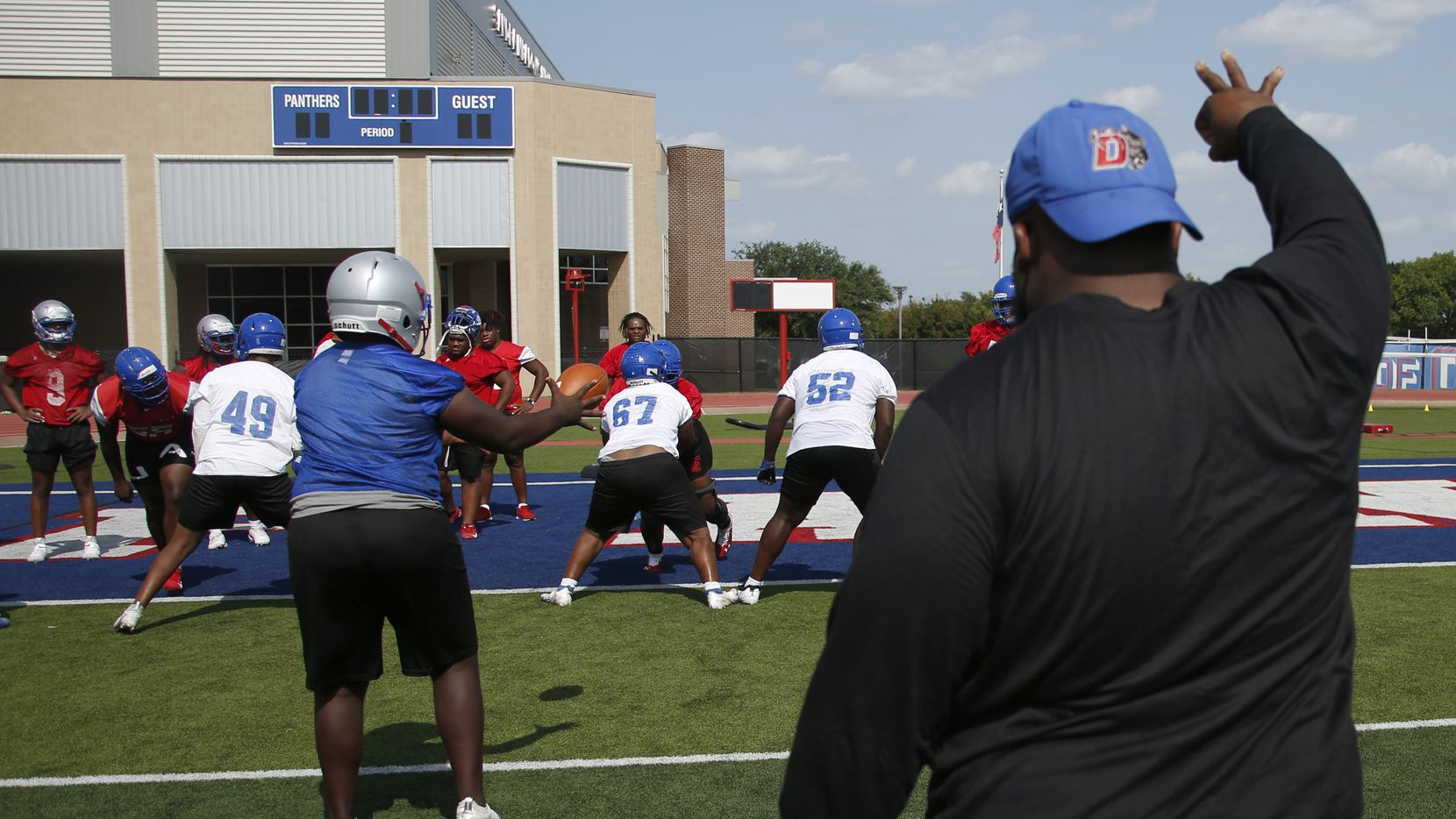 Duncanville Panthers work on a snap drill under the direction of an assistant coach. The Duncanville varsity football team conducted their 2021season football opening practice at Panther Stadium in Duncanville on August 9, 2021. (Steve Hamm/ Special Contributor)