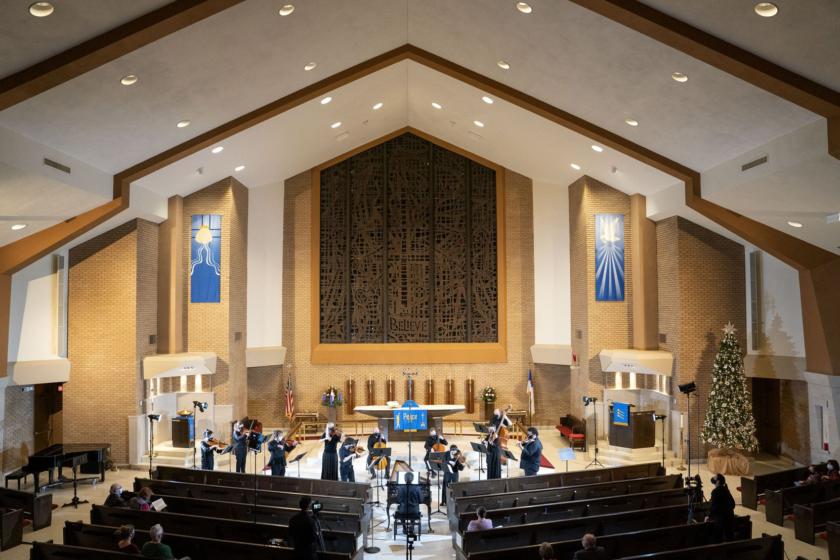 The Dallas Bach Society's orchestra, led by conductor James Richman, performs their Christmas Concertos concert Jan. 1, 2017 at Zion Lutheran Church in Dallas.