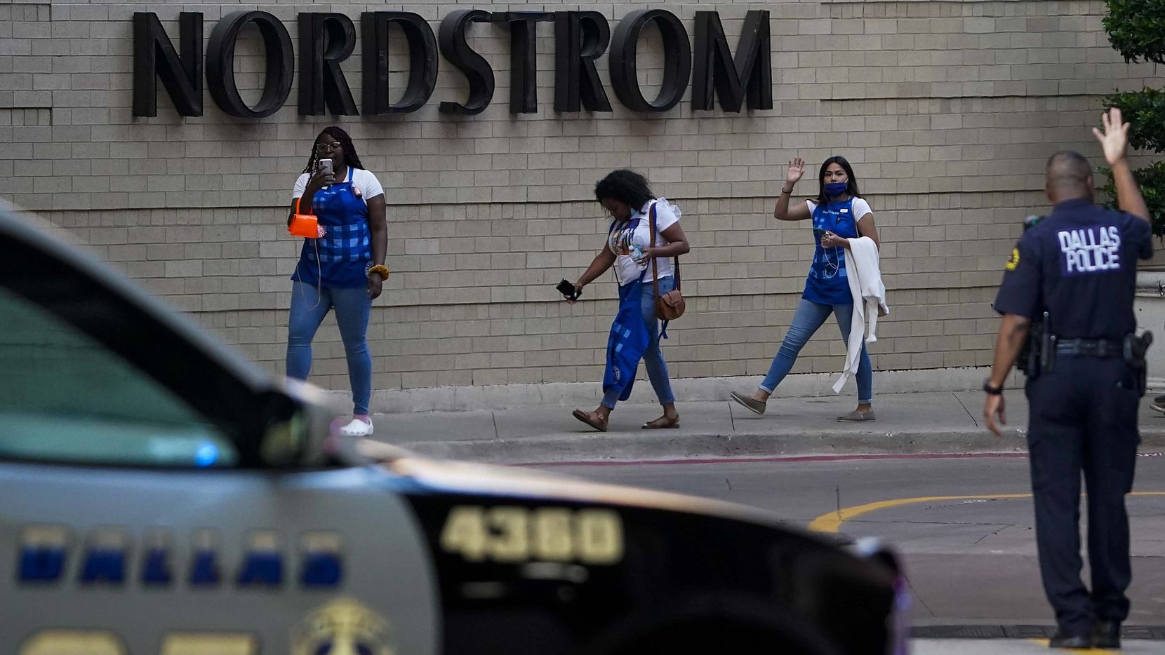 Dallas police direct people away from the Nordstrom store at the Galleria Dallas on Tuesday.