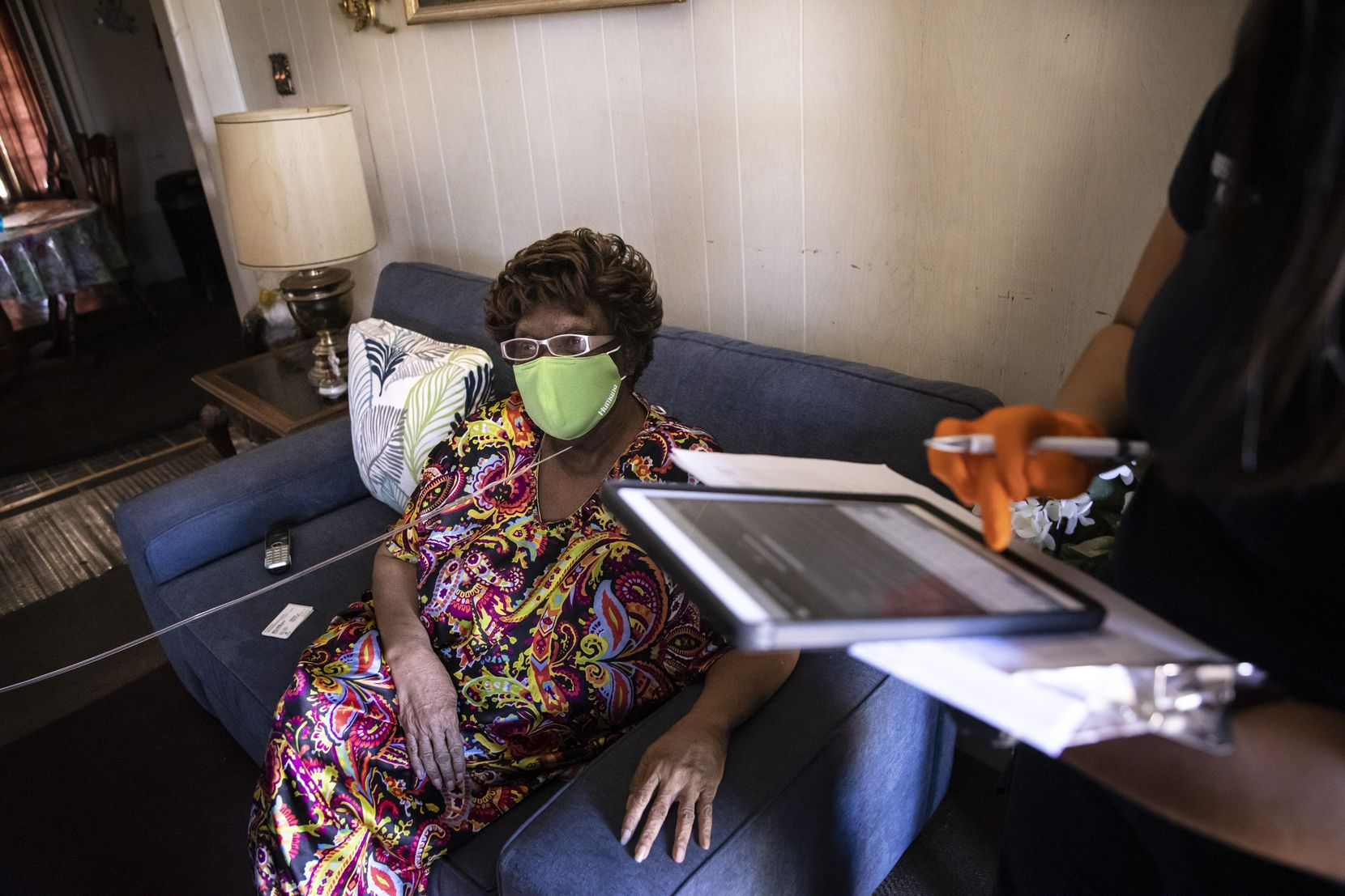 Firefighter/paramedic Kassandra Goce surveyed and monitored Erma Adams, 80, after Adams received her first dose of the Moderna COVID-19 vaccine Monday at her home in Corpus Christi.