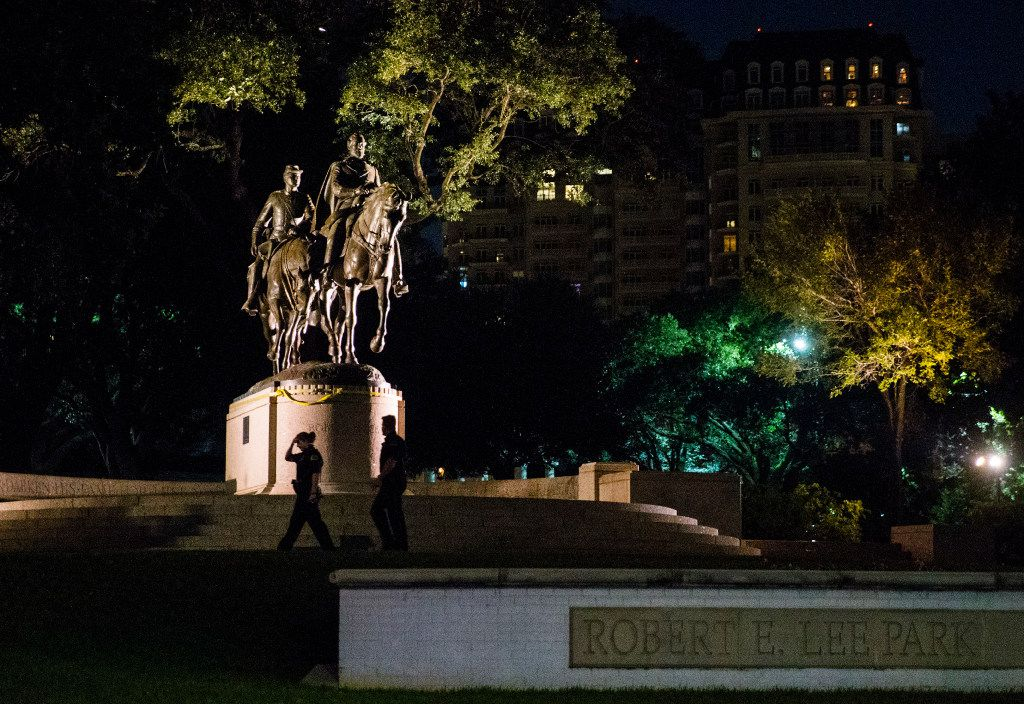Police officers patrol the area around a statue of Robert E. Lee around 10:30 p.m. on Wednesday, September 6, 2017 at Robert E. Lee Park in the Turtle Creek area of Dallas. (Ashley Landis/The Dallas Morning News)