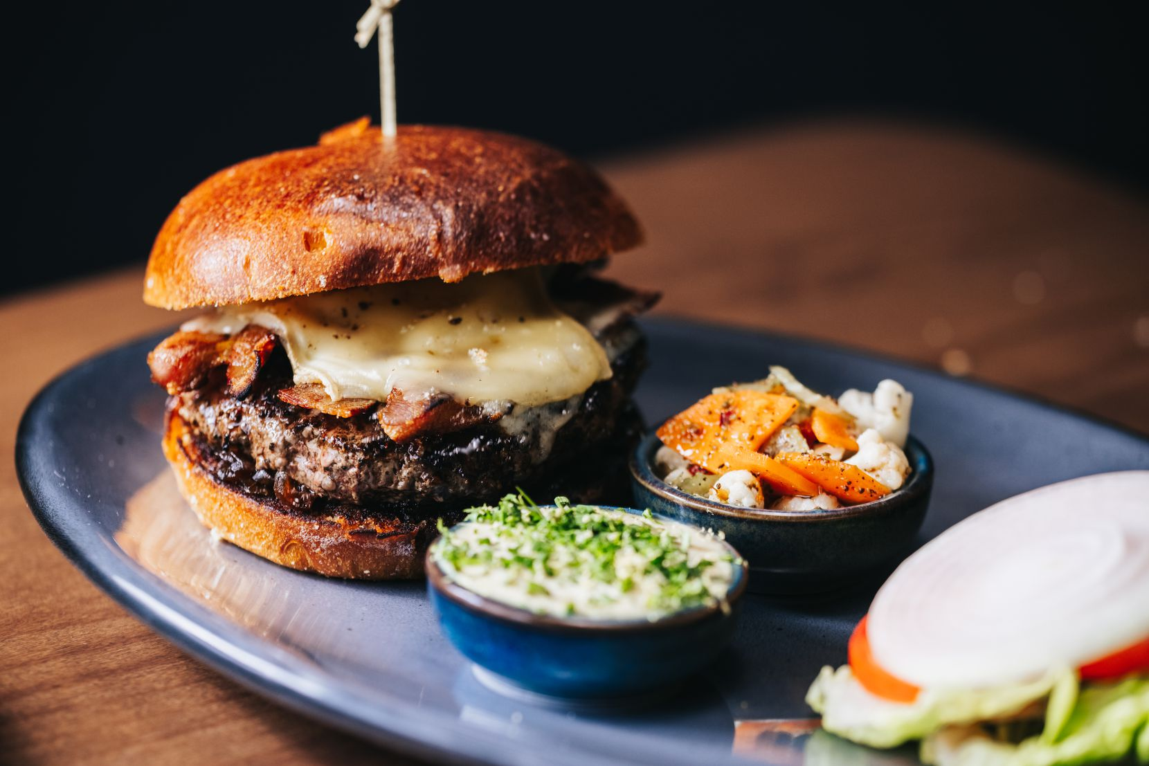 Ounce, a restaurant in downtown Dallas' AT&T Discovery District, sells a burger created by chef Brian Zenner.