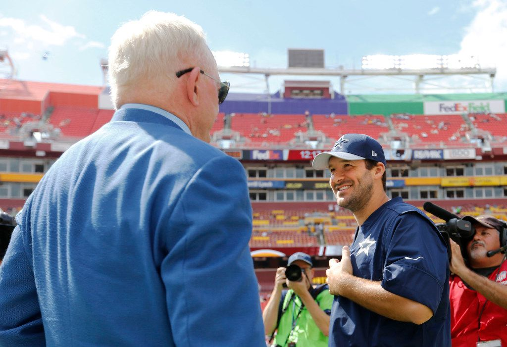 Dallas Cowboys owner and general manager Jerry Jones talks with Dallas Cowboys quarterback Tony Romo (9) before a game between the Dallas Cowboys and Washington Redskins at FedEx Field in Landover, Maryland on Sunday, September 18, 2016.