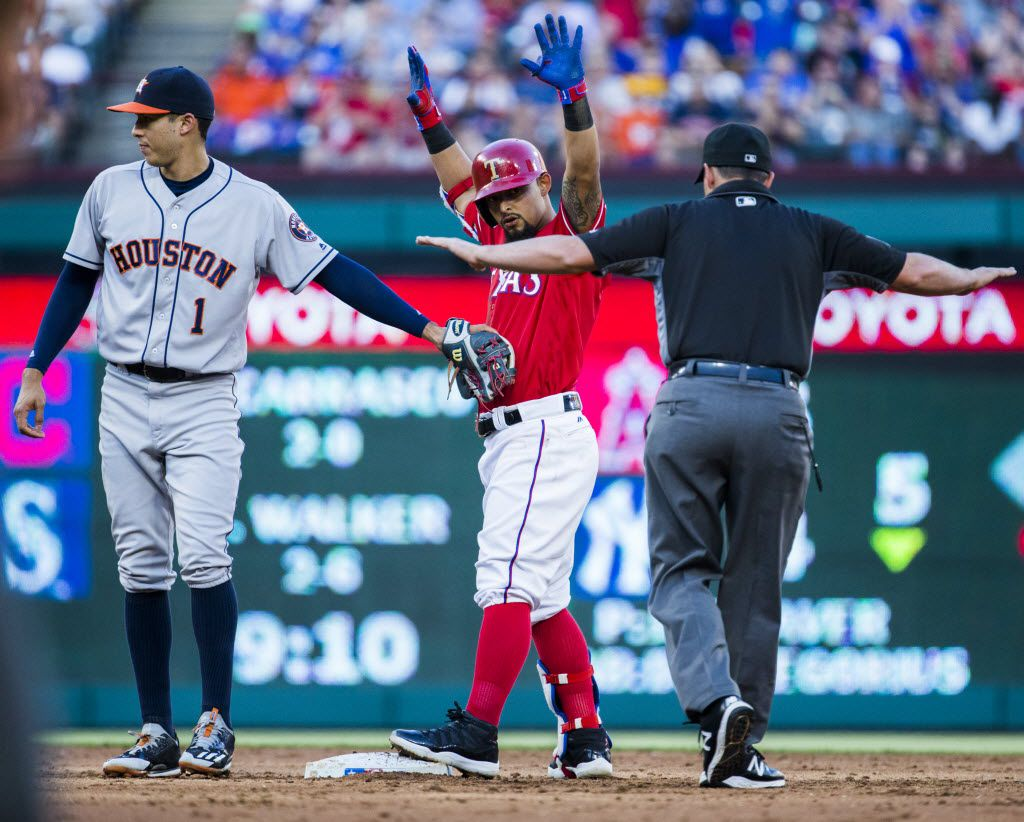 Texas Rangers second baseman Rougned Odor (12) is called safe at second base as Houston Astros shortstop Carlos Correa (1) tags him during the third inning of their game on Wednesday, June 8, 2016 at Globe Life Park in Arlington, Texas. (Ashley Landis/The Dallas Morning News)