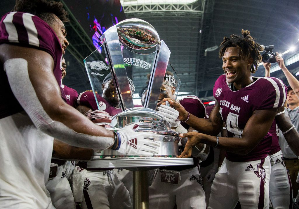 The Texas A&M Aggies accept the Southwest Classic trophy after a 24-17 win over Arkansas Razorbacks on Saturday, September 29, 2018 at AT&T Stadium in Arlington, Texas. (Ashley Landis/The Dallas Morning News)