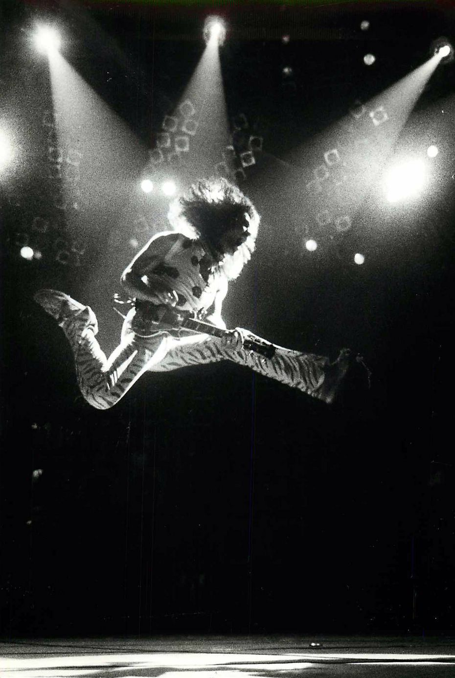 Eddie Van Halen leaps into the air at Reunion Arena in Dallas in July 1984.