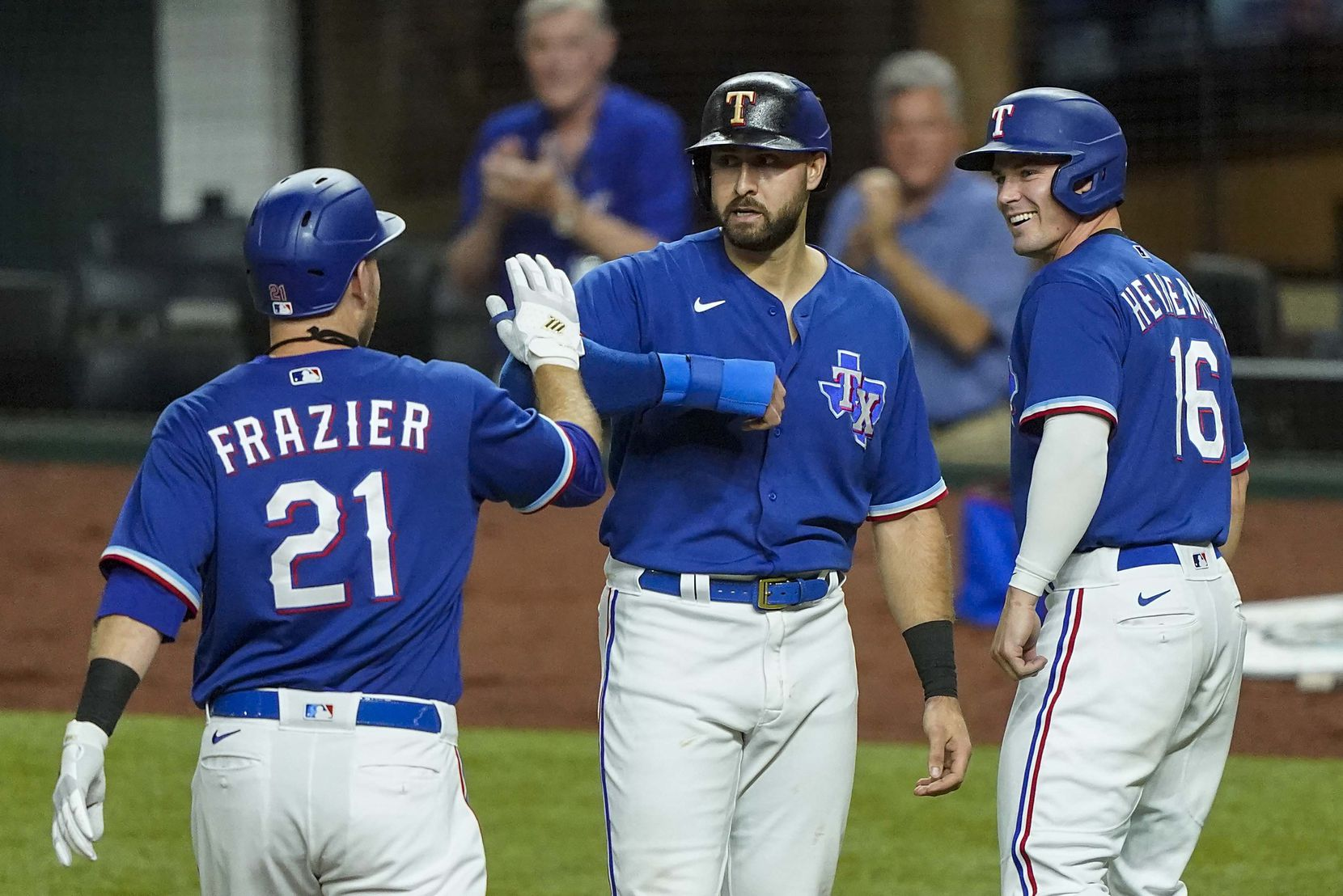 Texas Rangers first baseman Todd Frazier celebrates with Joey Gallo and Scott Heineman after driving them in with a 3-run home run during the fifth inning of an exhibition game against the Colorado Rockies at Globe Life Field on Wednesday, July 22, 2020.