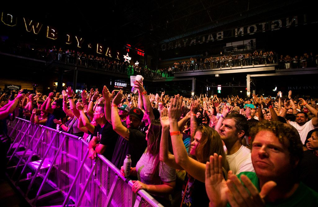 Guests cheer for the Toadies during the grand opening celebration for Texas Live! on Thursday, Aug. 9, 2018 in Arlington.