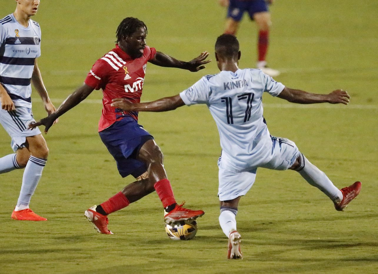FC Dallas midfielder Ema Twumasi (22) looks to pass as Sporting Kansas City midfielder Gadi Kinda (17) defends during the first half as FC Dallas hosted Sporting Kansas City at Toyota Stadium in Frisco on Wednesday, September 29, 2021. (Stewart F. House/Special Contributor)