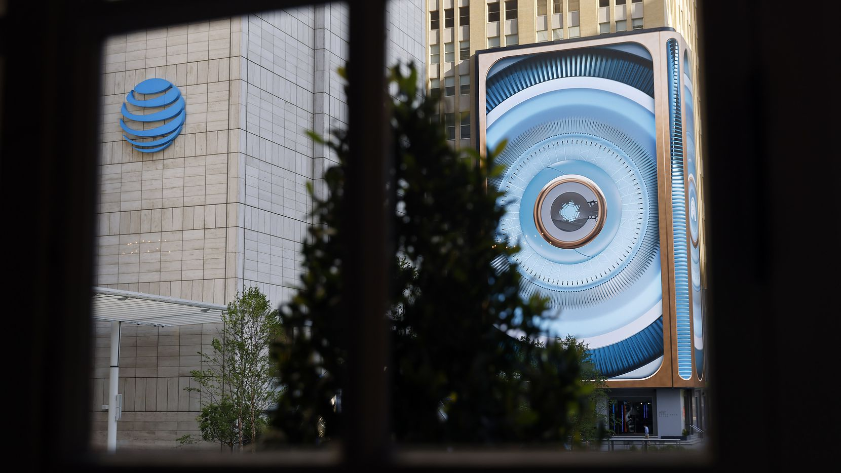 The AT&T headquarters are at the heart of the new AT&T Discovery District and its large media wall in downtown Dallas.