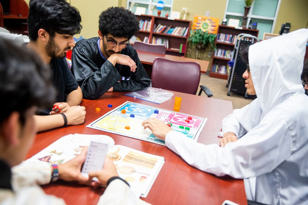 Daniyal Hussain, left, plays Ludo with Faraj Khan Pathan, middle, and Talha Mohammed, right, at Islamic Association of Collin County in Plano Texas Saturday, June 1, 2019. (Shaban Athuman/Staff Photographer)