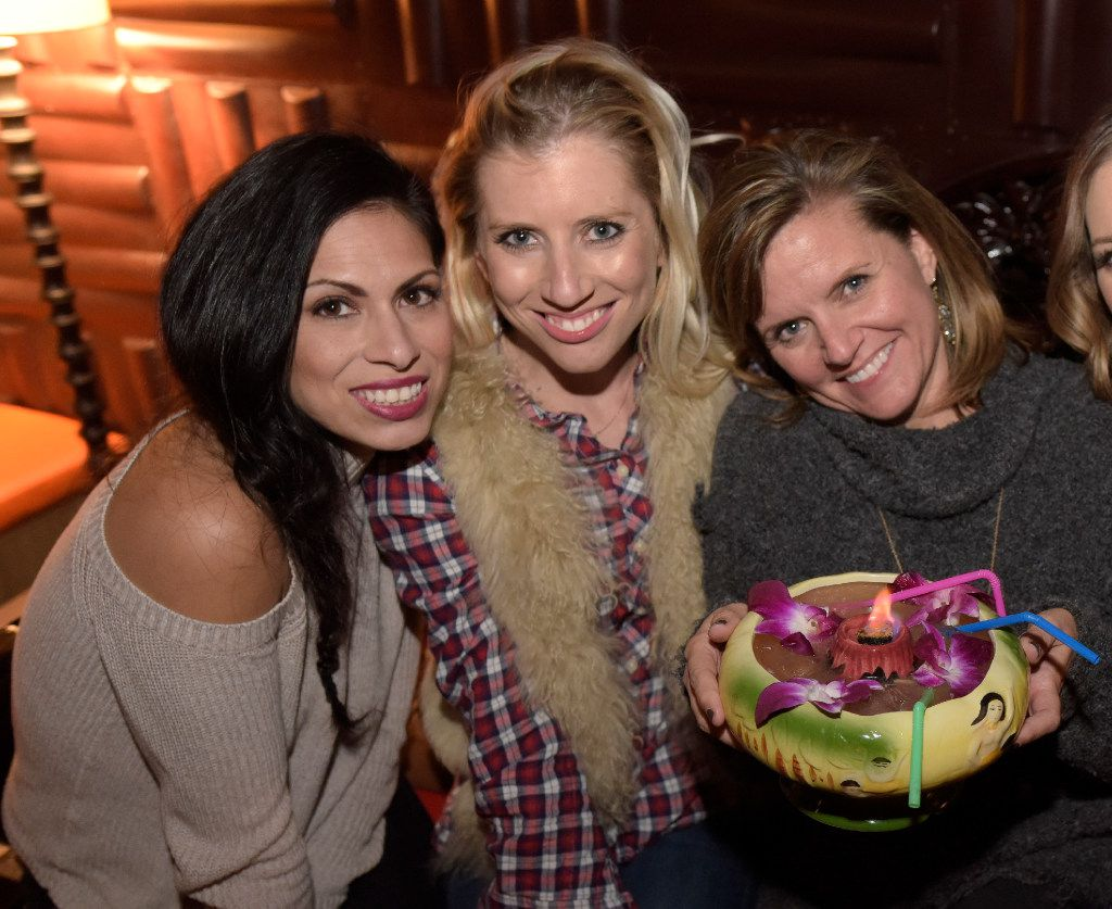 Shannon Fernandez, left, Robyn Byers, center, and Alana Gilhang enjoy a night at Pilikia, a tiki bar on Ross Ave., open in the former Three Sheets location.   (Rex C. Curry/Special Contributor)