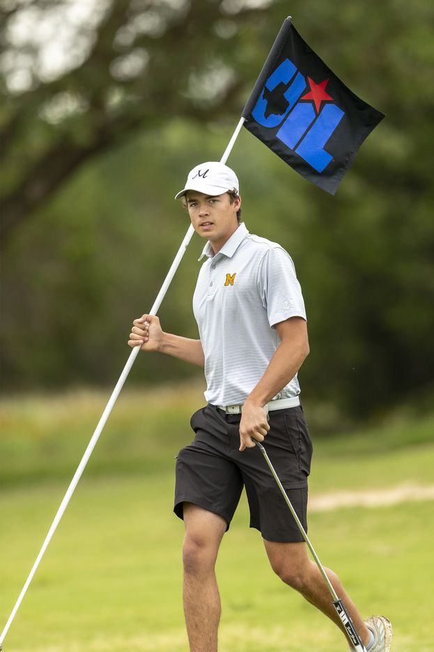 MansfieldÕs Ryan Hailey removes the pin on the 2nd green during the final round of the UIL Class 6A boys golf tournament in Georgetown, Tuesday, May 18, 2021. (Stephen Spillman/Special Contributor)