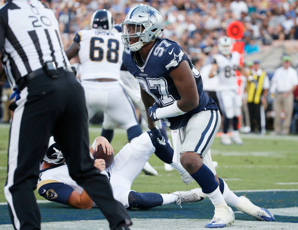 Dallas Cowboys defensive end Taco Charlton (97) gets up after sacking Los Angeles Rams quarterback Sean Mannion (14) during the first half of play in a preseason game between the Dallas Cowboys and Los Angeles Rams at Los Angeles Memorial Coliseum in Los Angeles, California on Saturday, August 12, 2017. (Vernon Bryant/The Dallas Morning News)