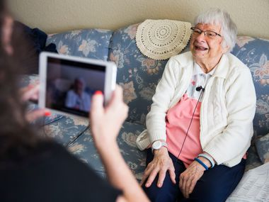 Irene Skurla is interviewed by Vibrant Life Director Lynn Brink using the OneDay app for senior citizens on July 24, 2018, at The Village at Mapleshade in Plano. The app allows staff members to interview residents, then send the videos to residents' family members.