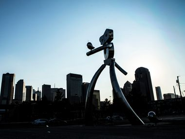 The giant sculpture is an icon for the Deep Ellum neighborhood, but not many know the story behind his happy strides.