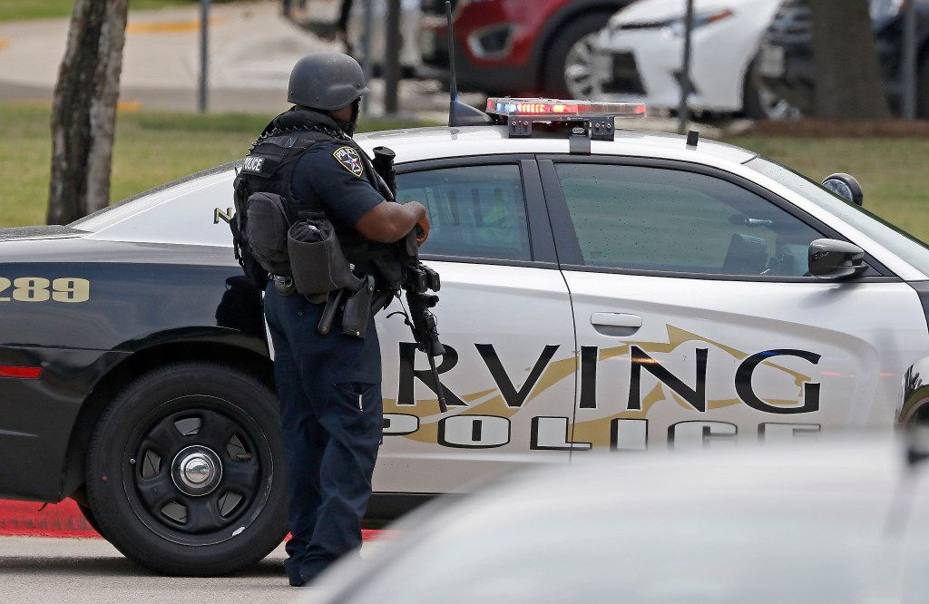 An Irving police officer works at the shooting scene on the North Lake College campus in Irving.