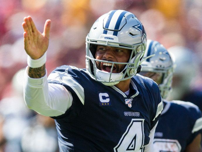 Dallas Cowboys quarterback Dak Prescott (4) signals a first down during the second quarter of an NFL game between the Dallas Cowboys and the Washington Redskins on Sunday, September 15, 2019 at FedExField in Landover, Maryland.