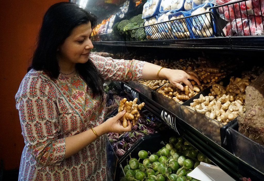 Sapna Punjabi-Gupta grabs some turmeric root while shopping at the India Bazaar in Irving.