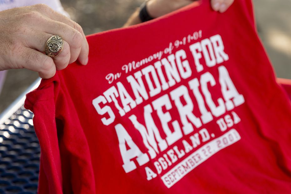 """Josh Rosinski displays an original T-shirt sold for Texas A&M's """"Red, White and Blue Out"""" game following the attacks on Sept. 11, pictured on Thursday, Sept. 2, 2021, in Richardson, Texas."""