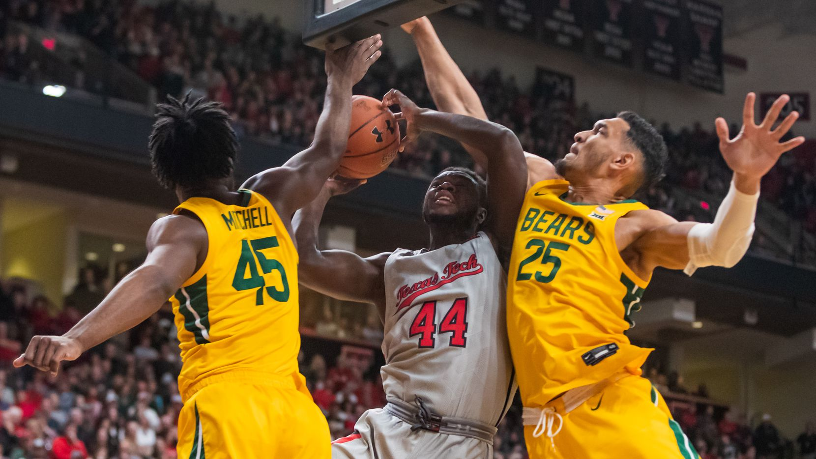 LUBBOCK, TEXAS - JANUARY 07: Guard Chris Clarke #44 of the Texas Tech Red Raiders is fouled by forward Tristan Clark #25 of the Baylor Bears during the first half of the college basketball game on January 07, 2020 at United Supermarkets Arena in Lubbock, Texas.