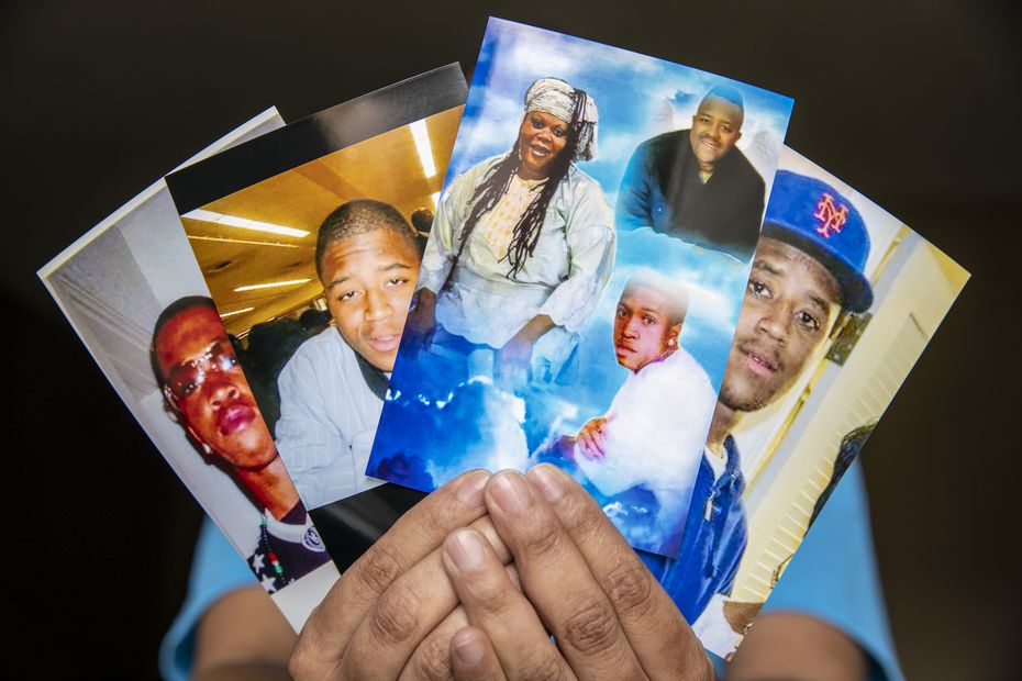 Nicole Hill holds several photos of deceased brothers Isaac (second from left) and Ishmael Mozeke (left) and their deceased mother Melody Bell, who also went by the name Afiah Bey (center) at her cousin's apartment in Dallas. Hill was a longtime family friend of the Mozeke brothers, both of whom died by gun violence two decades apart. Bey died mere weeks after Isaac was shot and killed in December 2020.