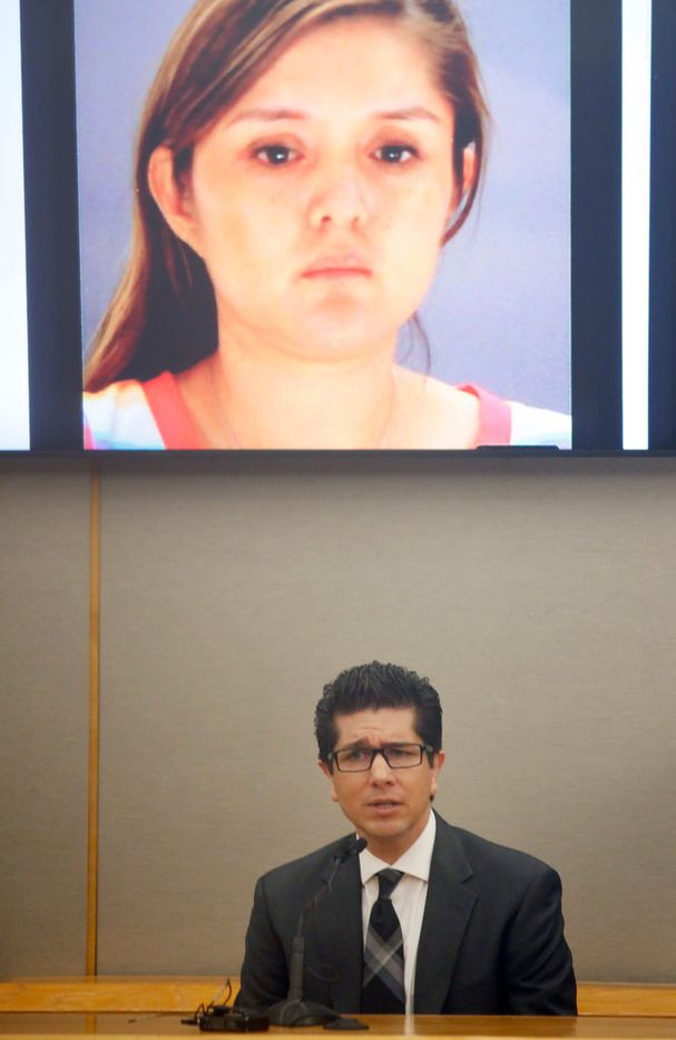 With a picture of his ex Brenda Delgado on the screen above him, Ricardo Paniagua testifies in the trial of his girlfriend's killer at the Frank Crowley Courts Building in Dallas.