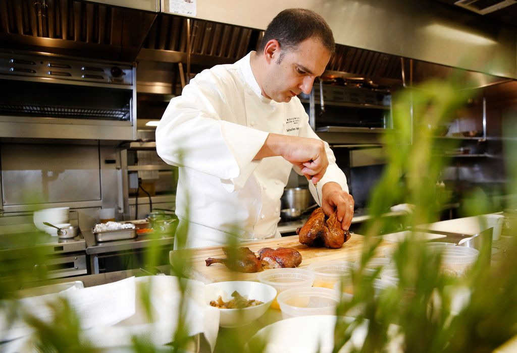 Executive chef Sebastien Archambault carves a roasted duck a l'orange