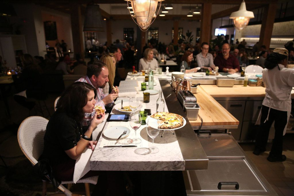 """The 13-seat """"charcuterie bar"""" is one of many dining areas at Sixty Vines. The charcuterie isn't made in-house, though."""