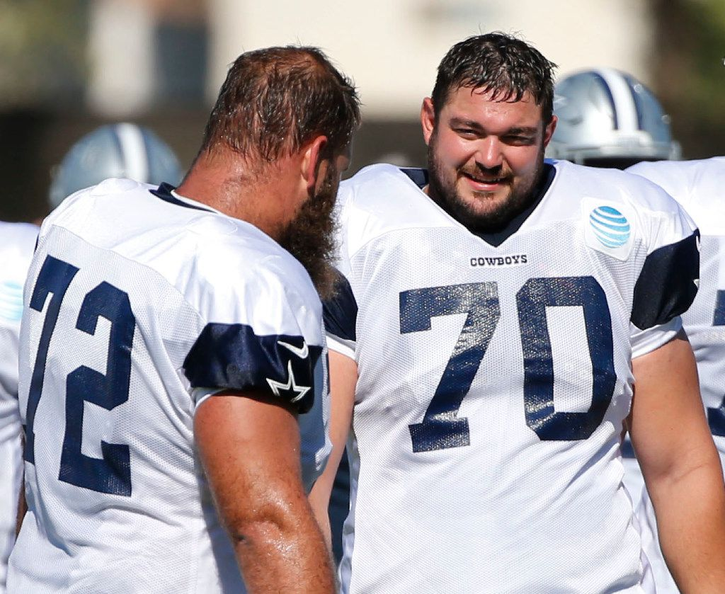 Dallas Cowboys center Travis Frederick (72) and Dallas Cowboys guard Zack Martin (70) during a break in play at the afternoon practice at training camp in Oxnard, California on Wednesday, July 26, 2017. (Vernon Bryant/The Dallas Morning News)