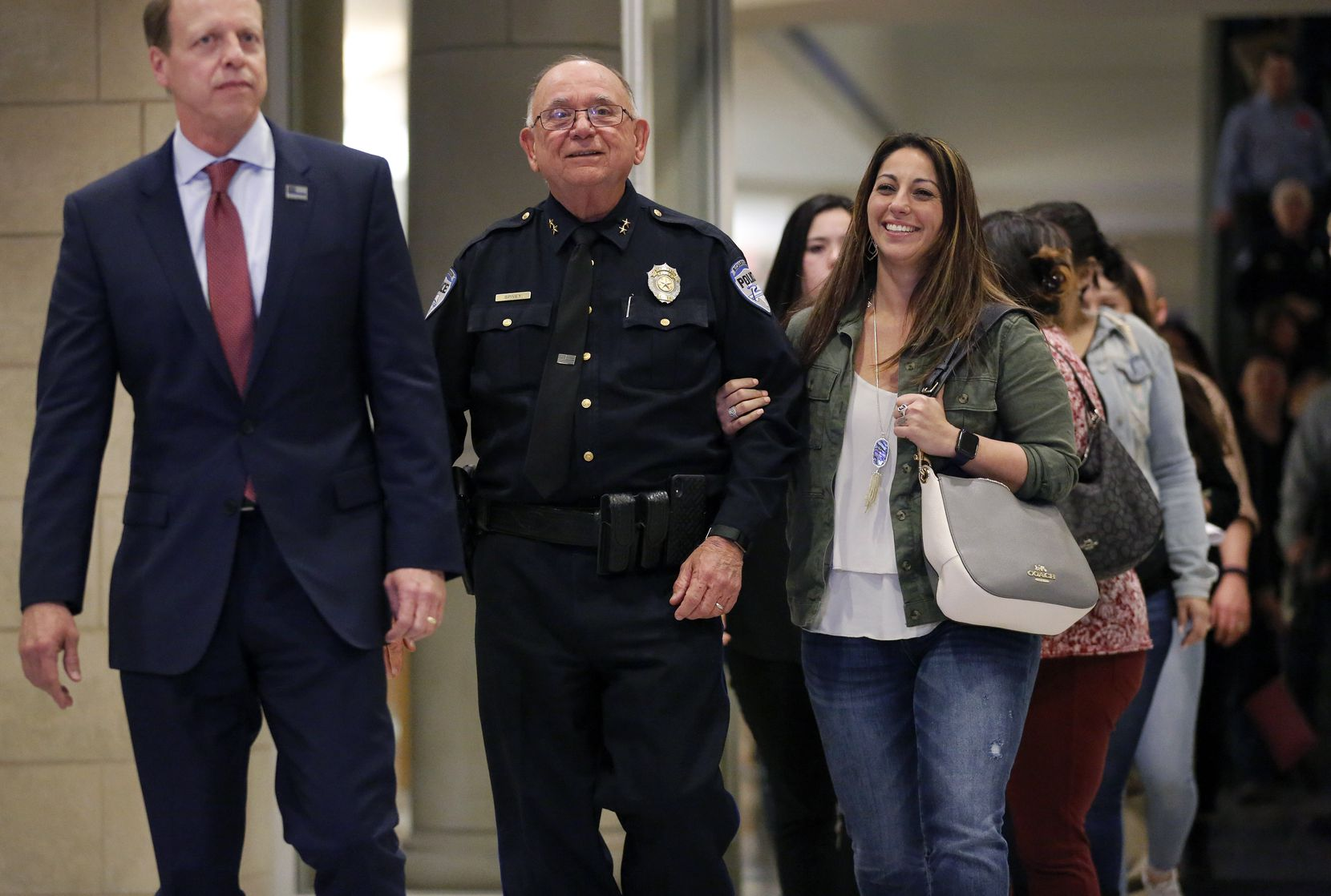 Collin County District Attorney Greg Willis (from left), Richardson Police Chief Jimmy Spivey and Nicole Sherrard, widow of slain police Officer David Sherrard, leave the Collin County Courthouse at the end of sentencing proceedings for Brandon McCall.