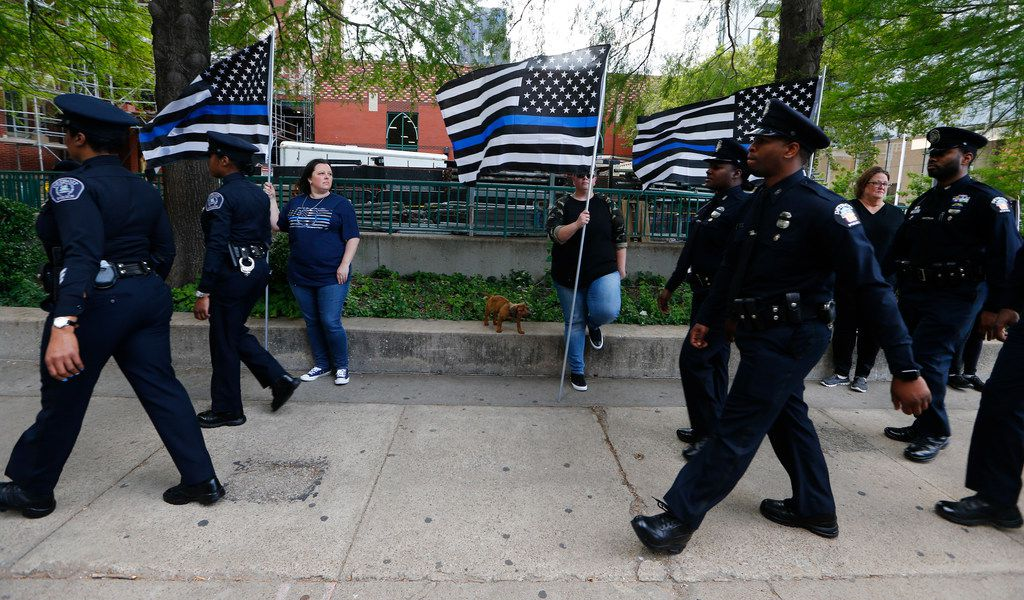 Police officer from Detroit walk by Melissa Gentry, (from left) Crystal Graham and Judi Gentri during a public visitation for Officer Rogelio Santander at Cathedral Shrine of the Virgin of Guadalupe in Dallas on Monday April 30, 2018. (Nathan Hunsinger/The Dallas Morning News)