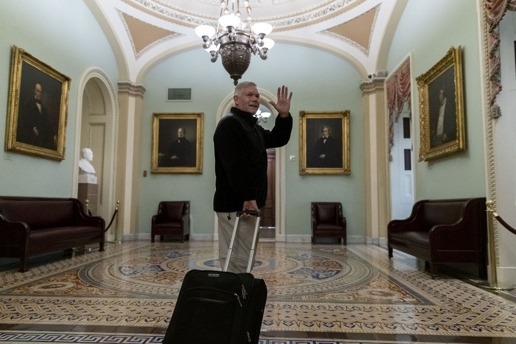 WASHINGTON, DC - DECEMBER 22: Rep. Pete Sessions (R-TX) waves to reporters as he departs the U.S. Capitol on December 22, 2018 in Washington, DC.