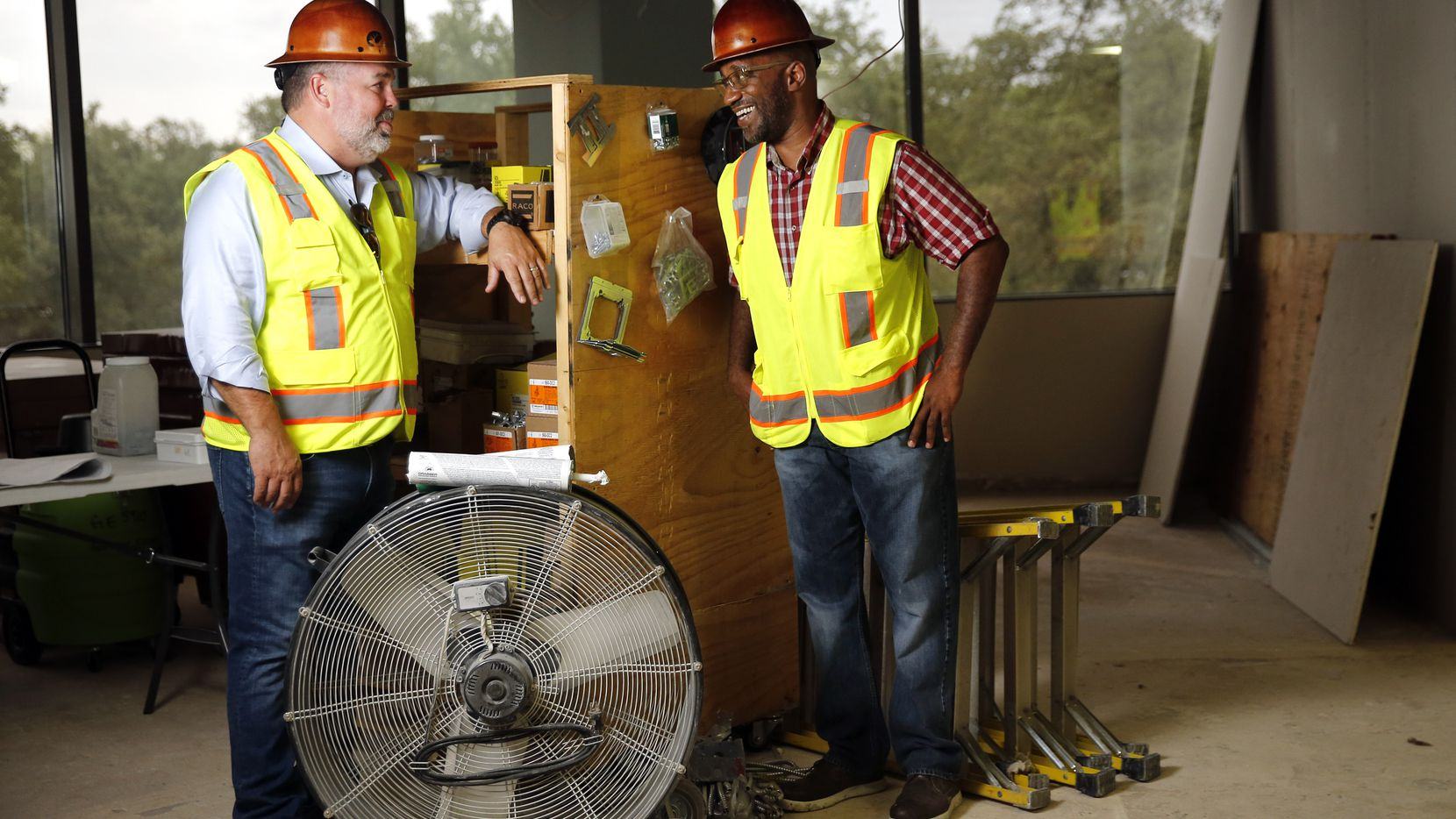 Gordon Highlander president Greg Gordon (left) makes a site visit with project manager Brian Thompson to a commercial office finish-out in Dallas on Sept. 9. Gordon posted a video discussion about Black Lives Matter with Thompson.