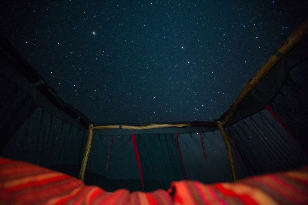Guests sleep under the night sky at the Loisaba Star Beds.