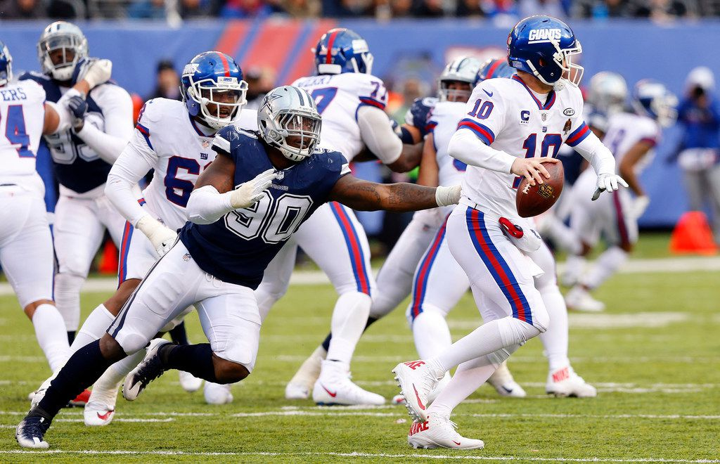 Dallas Cowboys defensive end Demarcus Lawrence (90) chases down New York Giants quarterback Eli Manning (10) during the second quarter at MetLife Stadium in East Rutherford, New Jersey, Sunday, December 10, 2017.