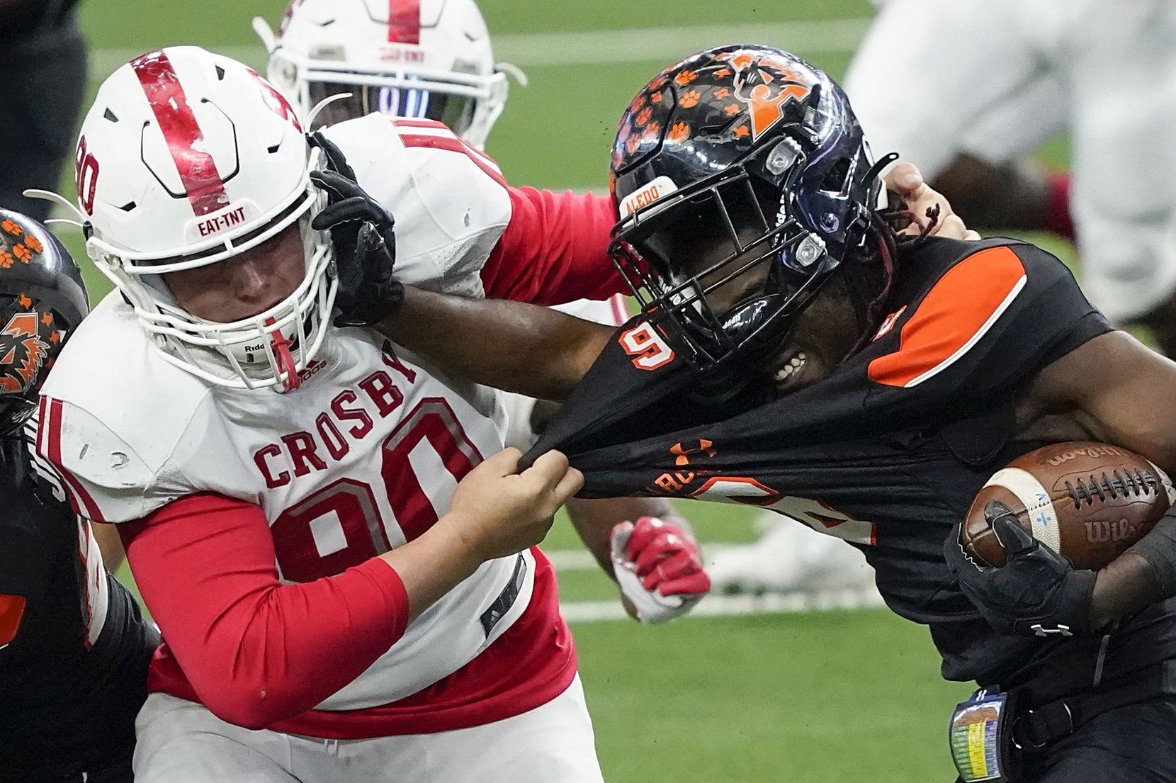 Aledo running back DeMarco Roberts (6) fights for yardage against Crosby defensive lineman Wade Lewis (90) during the first half of the Class 5A Division II state football championship game at AT&T Stadium on Friday, Jan. 15, 2021, in Arlington. (Smiley N. Pool/The Dallas Morning News)