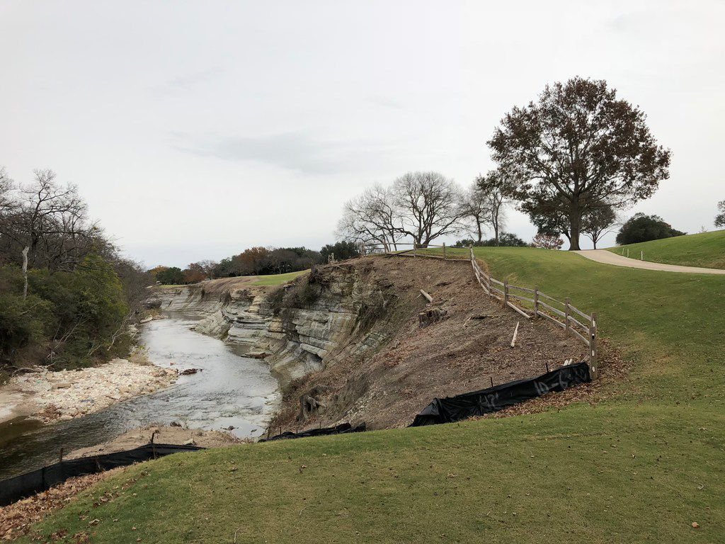 The tee shot on the newly renovated par-5 14th hole at Northwood Club in Dallas requires the golfer to hit over White Rock Creek to an uphill fairway.