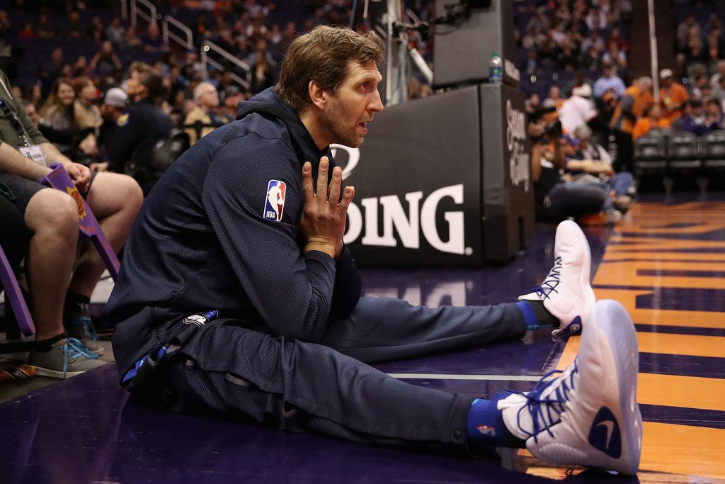 PHOENIX, ARIZONA - DECEMBER 13:  Dirk Nowitzki #41 of the Dallas Mavericks warms up on the sidelines during the first half of the NBA game against the Phoenix Suns at Talking Stick Resort Arena on December 13, 2018 in Phoenix, Arizona. NOTE TO USER: User expressly acknowledges and agrees that, by downloading and or using this photograph, User is consenting to the terms and conditions of the Getty Images License Agreement. (Photo by Christian Petersen/Getty Images)