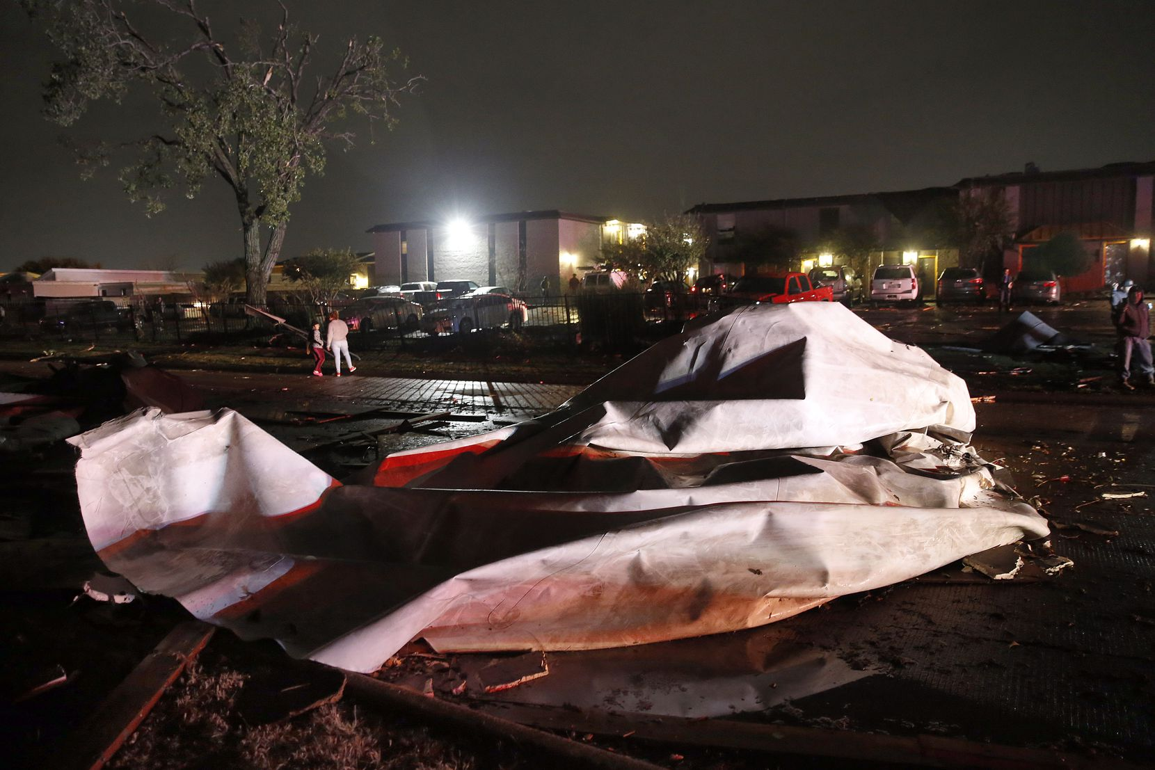 Roofs from The Mirage Apartments complex were torn off and landed on Pioneer Parkway in Arlington following a tornado-warned storm, Tuesday night, November 24, 2020. Air conditioner units and other structural debris were scattered across the property.