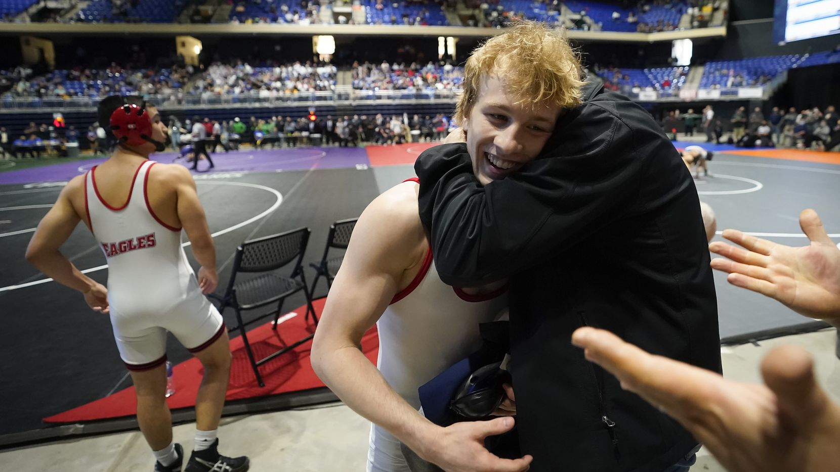 Braxton Brown of Allen celebrates after beating  Micah White of Humble Kingwood for the 6A boys 120-pound championship, Brown's fourth state title, during the UIL State Wrestling tournament at the Berry Center on Saturday, April 24, 2021, in Cypress, Texas.