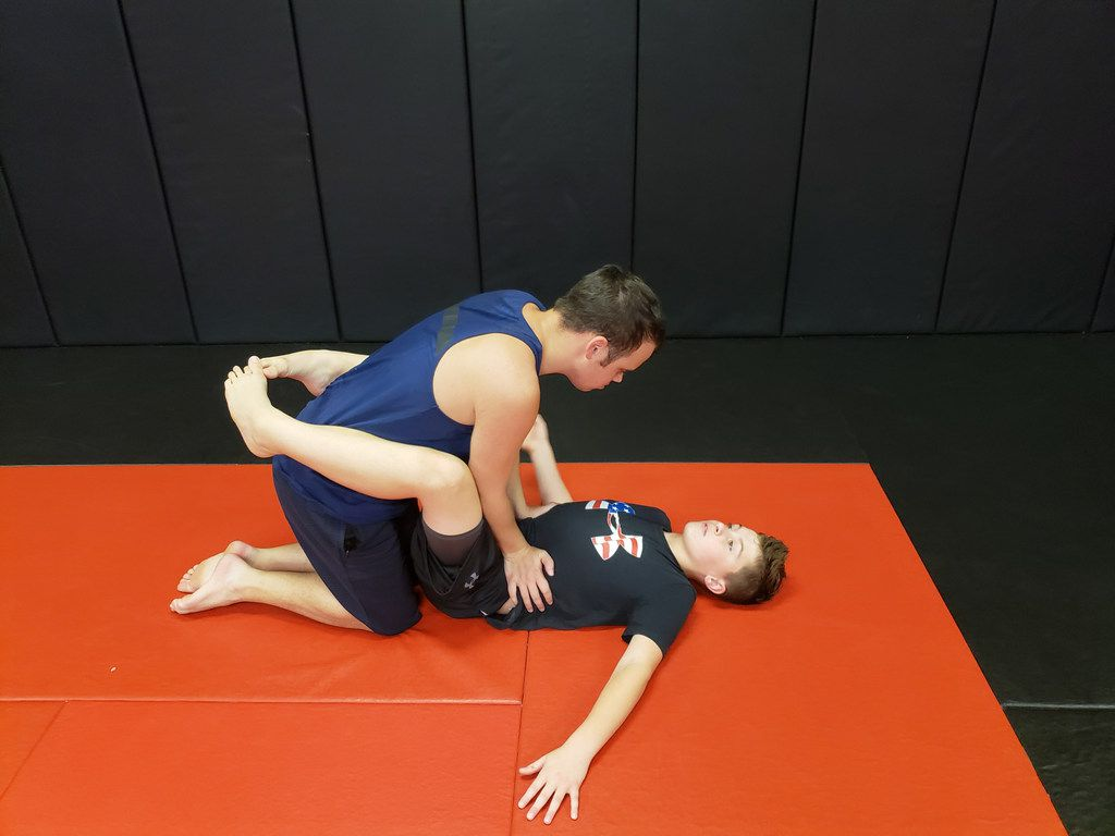 Dylan Miller and Trevor Meyer practice a jiu-jitsu drill at Fitness Fight Factory in North Richland Hills, Texas. Devin Miller, a mixed martial arts fighter, holds a special needs class for his brother Dylan and others with autism.